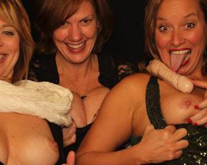 Women showing tits in a Photo Booth