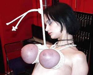 Breasts suspended bondage by