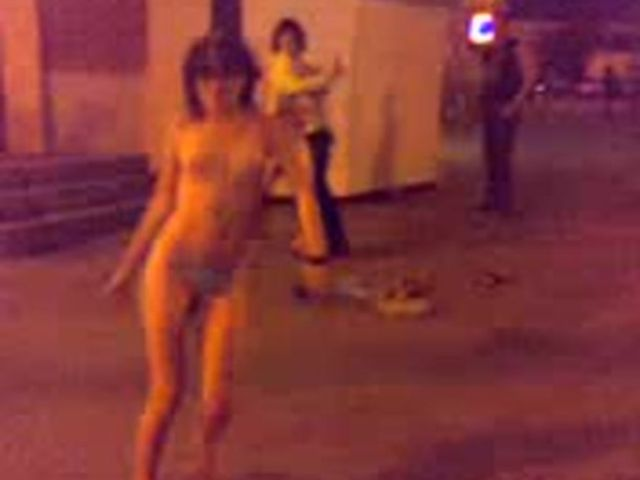 Drunk girl stripping naked on streets after club