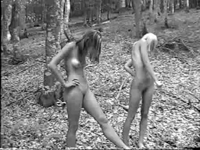 2 sexy ukrainian gymnasts striping in the forest