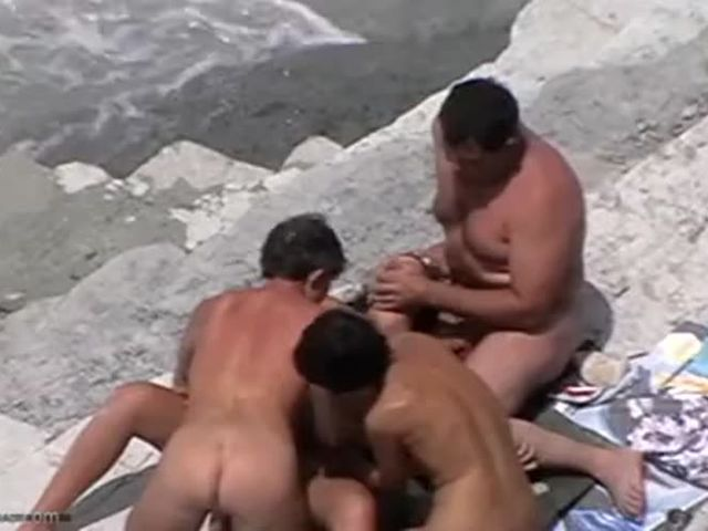Wife swapping at a nude beach gets caught at Porn Yeah.mp4->