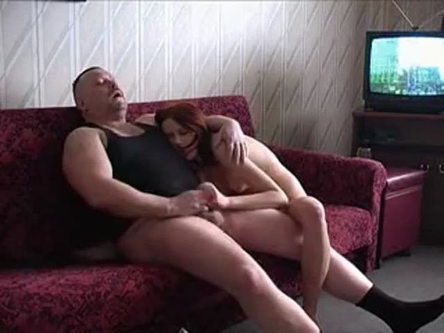 Young Russian redhead with daddy on couch