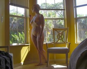 Blond mature wife posing at home